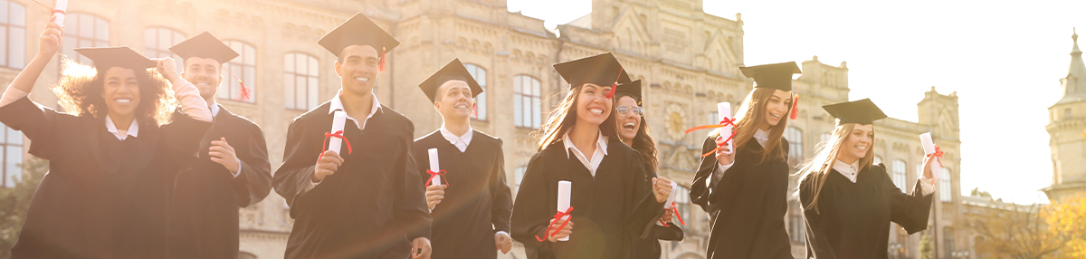 Happy students with diplomas near campus.